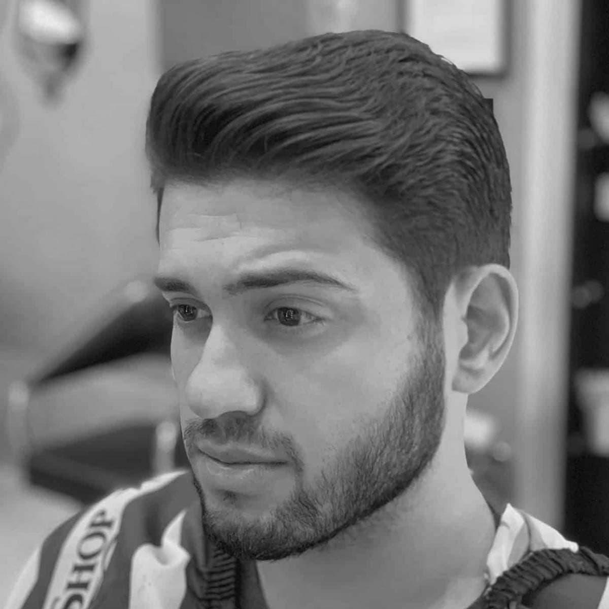 Corte con tijera para hombres en la barbería YB New Style Barber Shop Madrid