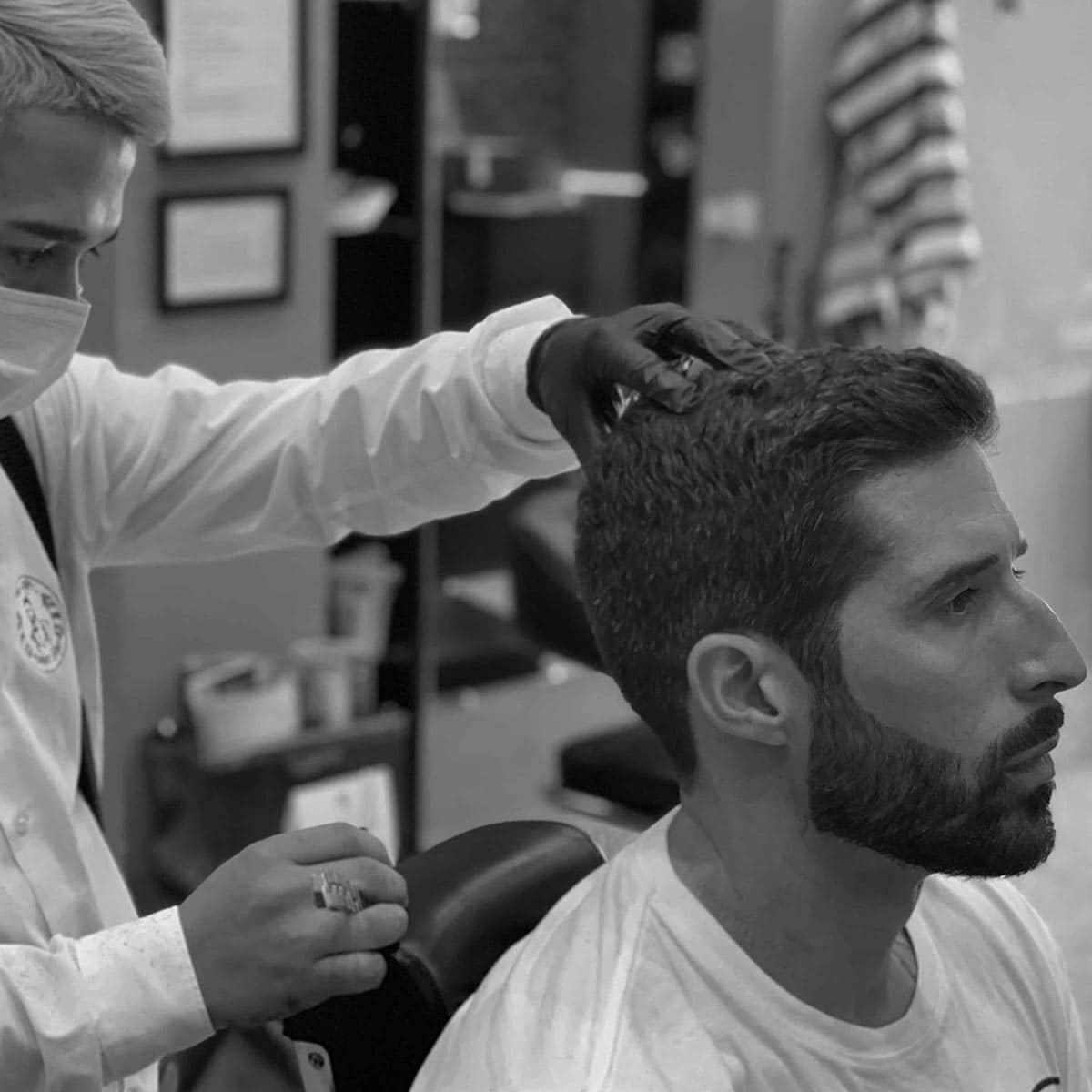 Corte con tijera y arreglo de barba en la barbería YB New Style Barber Shop Madrid