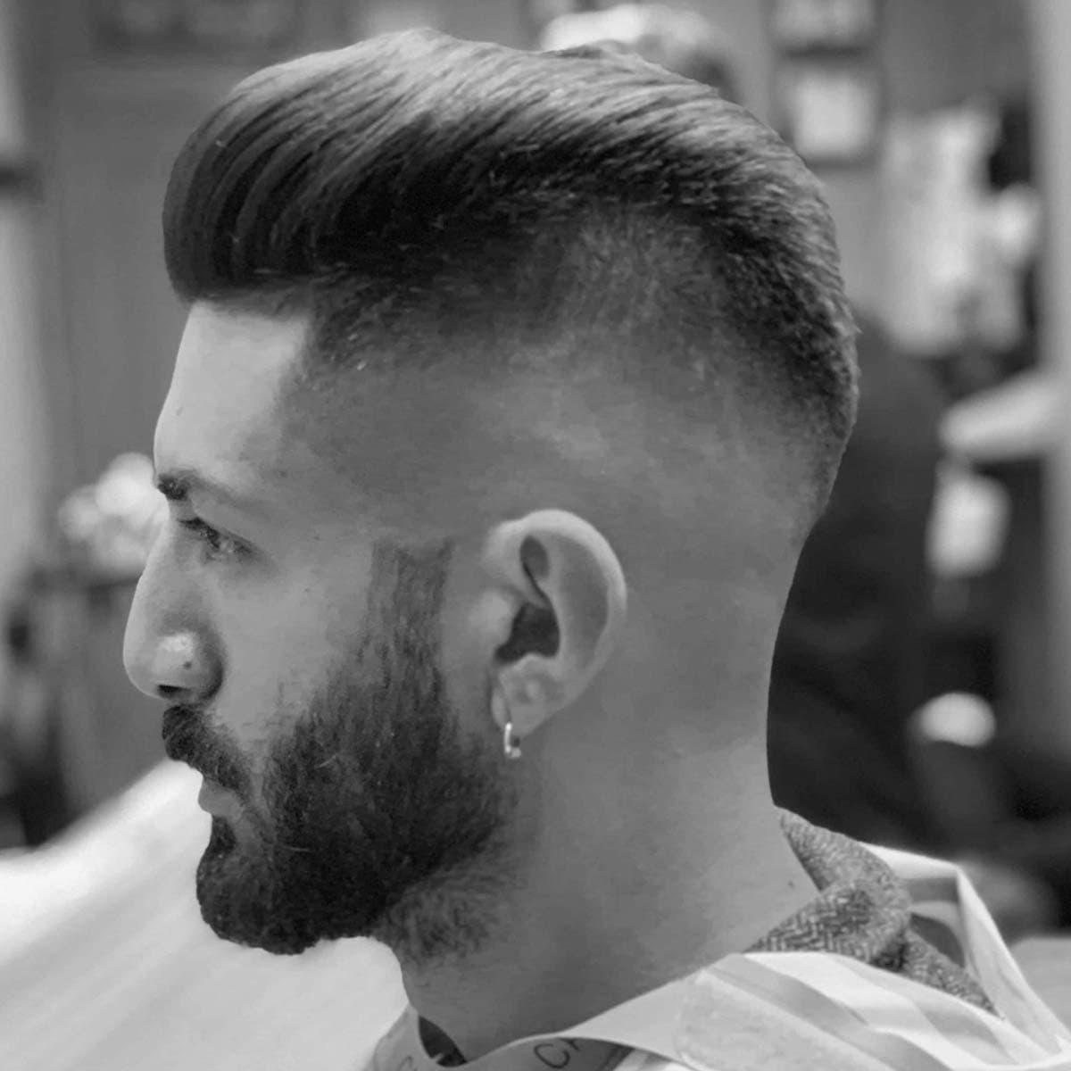 Corte y peinado para hombres en la barbería YB New Style Barber Shop Madrid