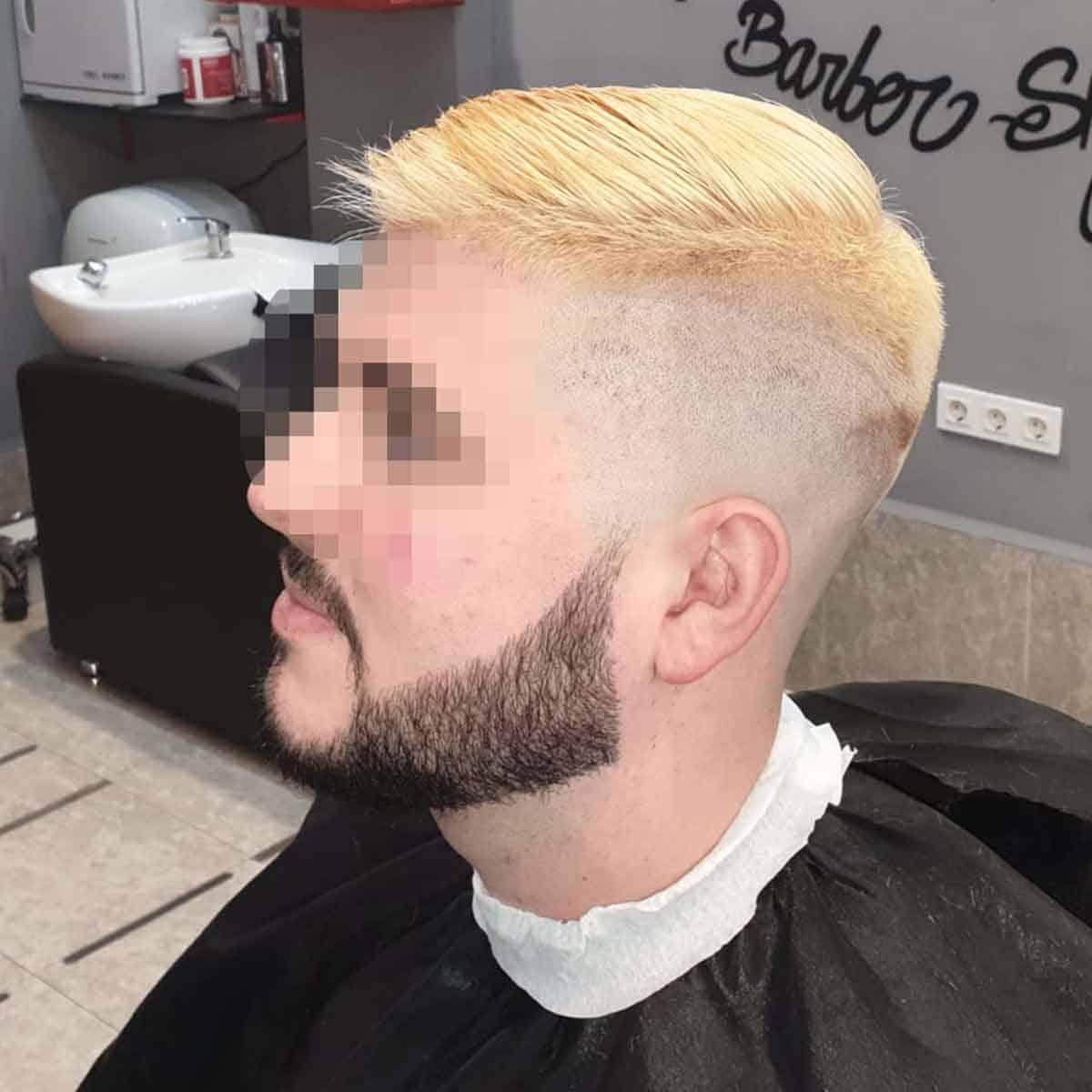 Decoloración corte skin fade y arreglo de barba en la barbería YB New Style Barber Shop